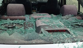 A car whose windows were smashed this week in Jalud.