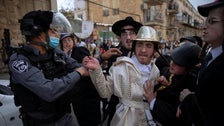 Ultra-Orthodox Jews scuffle with police officers in Mea Shearim.
