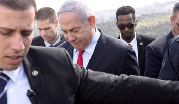 Benjamin Netanyahu walks to get an overview of the East Jerusalem settlement of Har Homa, last year.