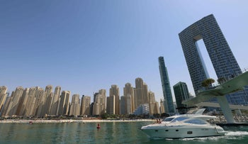 A boat cruises past the Jumeirah Beach Residence in Dubai, on Wednesday.