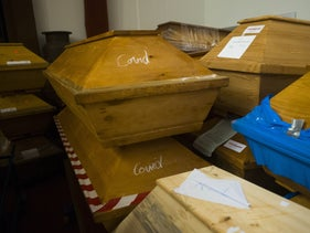 Caskets labeled with the word 'Covid' are stacked with others coffins in a memorial hall in Meissen, Germany, two months ago.