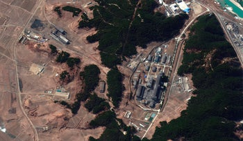 Satellite image showing a steam plant, left, and North Korea's main atomic complex, right, in Yongbyon, North Korea on Tuesday