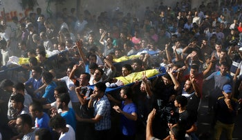 The funeral procession for four boys killed on a beach in Gaza during an Israeli attack, in 2014.
