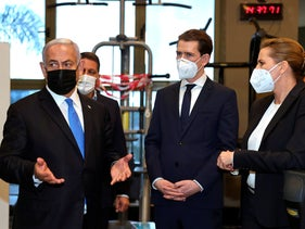 "Israeli Prime Minister Benjamin Netanyahu, left, visits a fitness gym with Austrian Chancellor Sebastian Kurz, center, and Danish Prime Minister Mette Frederiksen, to observe how the ""Green Pass,"" for citizens vaccinated against COVID-19, is used"