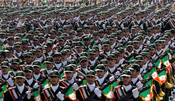 Iran's Revolutionary Guard troops march, during a military parade commemorating the start of the Iraq-Iran war in 2012.
