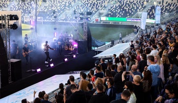 Israeli musician Ivri Lider performs in front of an audience of green passport holders in a stadium in Tel Aviv.