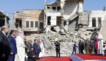 Pope Francis, surrounded by shells of destroyed churches, attends a prayer for the victims of war at Hosh al-Bieaa Church Square, in Mosul, Iraq, once the de-facto capital of ISIS