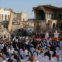 People attending a prayer by Pope Francis for war victims at 'Hosh al-Bieaa' in Mosul's Old City, today