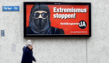 A poster of the initiative committee against wearing the burqa reads 'Stop extremism! Veil ban - Yes' is seen in Zurich Switzerland.