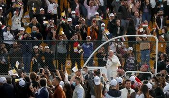 Pope Francis arrives to hold a Mass at Franso Hariri Stadium in Erbil, Iraq, today.