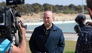 Yamina Chairman Naftali Bennett speaks to the press while on a tour of the Omer Regional Council in the Negev, last month.