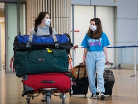 Israelis returning from abroad at Ben-Gurion International Airport, Thursday.