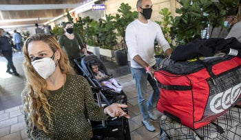 Travelers at Ben-Gurion Airport on Sunday.