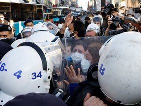Supporters of the pro-Kurdish Peoples' Democratic Party (HDP) face off police officers as they gather to support Bogazici University students in Istanbul, Turkey last month