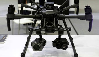 FILE PHOTO: A DJI drone is pictured at their booth at Interpol World in Singapore