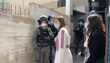 Police officers dispersing crowds at the International Women's Day event in East Jerusalem earlier today.
