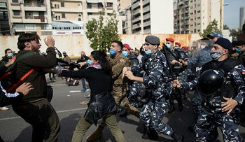Lebanese riot police and army soldiers scuffle with anti-government protesters