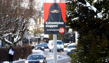 A poster of the initiative committee against wearing the Burka reads 'Stop extremism! Veil ban -Yes' in Berikon, Switzerland.