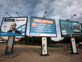 Election campaign posters in the southern city of Rahat, on Wednesday.