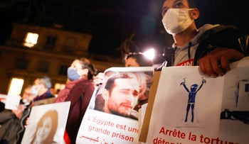 Human rights activists stage a protest over human rights violations in Egypt in Paris, France.