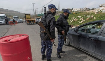 Palestinian security forces stop vehicles as part of lockdown measures in Ramallah, this week.