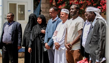 Members representing African communities in Yemen gather to speak in front of the offices of the International Organization for Migration in Sanaa, on Saturday.