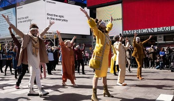 """Broadway actors perform in New York's Times Square, Friday, March 12, 2021. The """"We Will Be Back"""" program commemorates the lost year on Broadway due to the coronavirus pandemic and attempts to shine some hope on the year to come"""