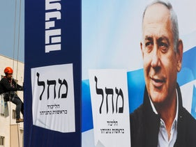 An election billboard for Benjamin Netanyahu being completed in Bnei Brak today.