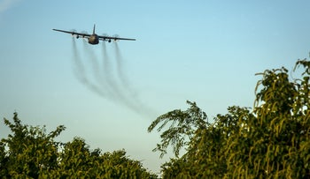 Spraying against mosquitoes using a C-130 Hercules