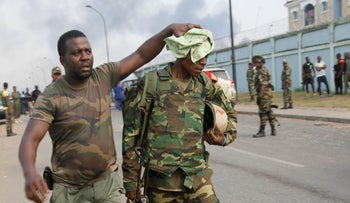 Members of Equatorial Guinea's military following explosions at an army base, last week.