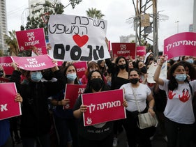 Protesters demonstrating against prosecutors' decision not to charge Yarin Sherf with the rape of a 13-year-old girl, Tel Aviv, today.