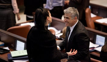 Labor Chairwoman Merav Michaeli and Yesh Atid's Yair Lapid in the Knesset, in 2013.
