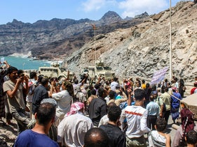 Protesters gather to demonstrate outside the internationally-recognised Yemeni government's headquarters in the southern port city of Aden, today