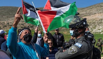 The Border Police close a road while Palestinian protesters try to reach a settler outpost near Beit Dajan in the West Bank this month.