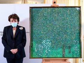 "French Culture Roselyne Bachelot poses next to Gustav Klimt's 1905 painting ""Rosebushes under the Trees"" on Monday"