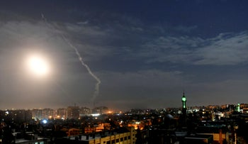 Missiles flying into the sky near international airport, in Damascus, Syria in 2019