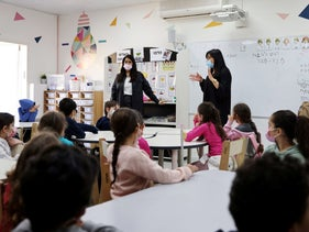 Elementary school students listen to their teachers in their classroom in Mevaseret, Israel, last month