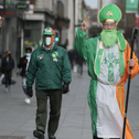 Three men dressed up to celebrate St Patrick's day on O'Connell Street in Dublin.