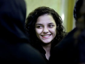 Sanaa Seif in 2014, receiving condolences for her father at Omar Makram Mosque after being temporarily released from prison, in Cairo, Egypt.