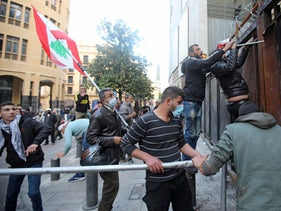 Lebanese demonstrators try to breach a fortified gate, leading to the Lebanese Parliament building in Beirut on March, last week.