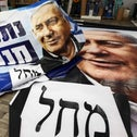 Employees prepare an election banner for Israeli Prime Minister Benjamin Netanyahu, head of the Likud party, at a printing factory in Rosh Haayin, ahead of the March 23 general election