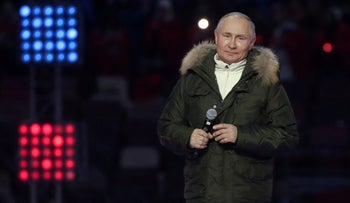 Russian President Vladimir Putin attends a concert marking the seventh anniversary of Russia's annexation of Crimea at Luzhniki Stadium in Moscow.