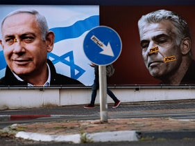 An election campaign billboard for the Likud party shows Netanyahu and Yair Lapid.