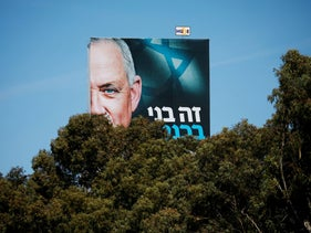 Part of a Blue and White party election campaign banner depicting Defense Minister Benny Gantz.