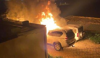 Cars on fire in Beit Iksa, last night.