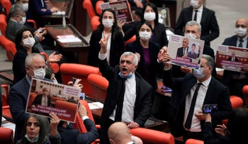HDP lawmaker Omer Gergerlioglu and other lawmakers from his party after the Turkish Parliament stripped him of his MP status, on Wednesday.