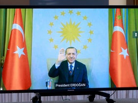 Turkey's Erdogan is seen on a screen during a video call with Ursula von der Leyen and Charles Michel, in Brussels.