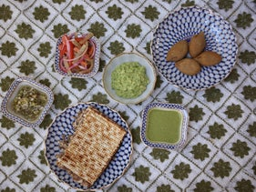 Alegra Smeke's Passover table includes a matzah meat pie; guacamole; chile güero encurtido, a mix of slices of carrots, tomatoes and red onions with olive oil, salt and lemon; and kibbeh, balls of meat mixed with toasted pine nuts and rice.