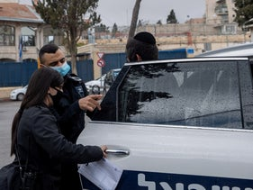 A suspect in the attack on Ibrahim Hamad in custody in Jerusalem, last month.