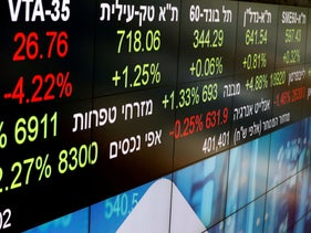 Market data is seen on an electronic board at the Tel Aviv Stock Exchange, last year.